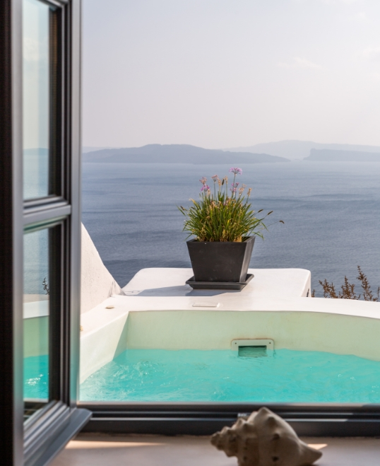 The breathtaking view from the of Nostos Apartments in Oia Santorini
