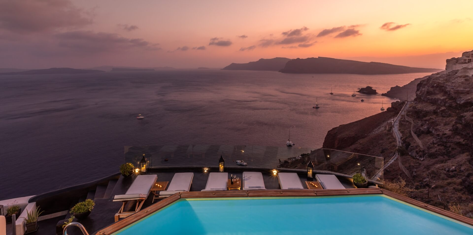 The breathtaking view from the balcony of Nostos Apartments in Oia Santorini