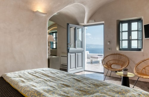 Lavish double bed offered from Nostos Apartments in Oia Santorini