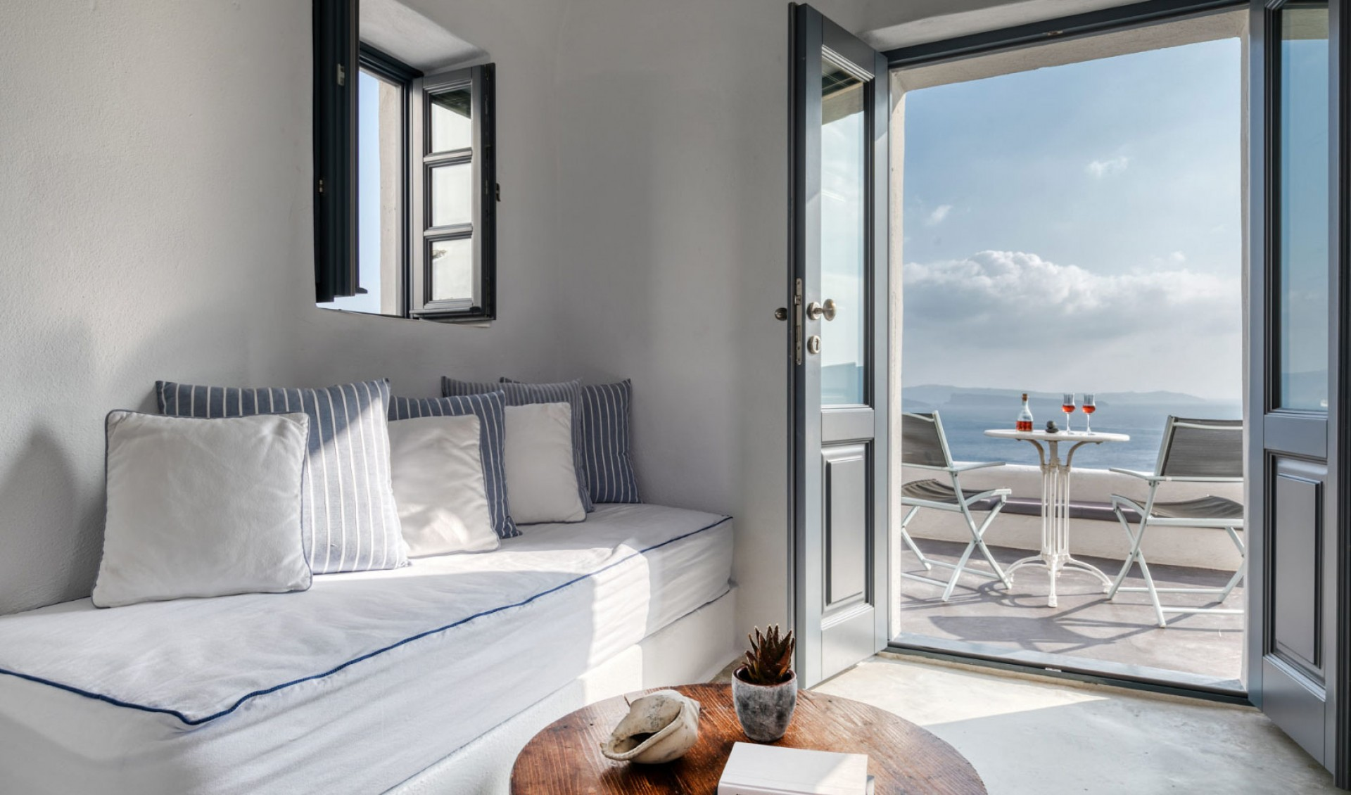 The interior of the luxury suite of Nostos Apartments in Oia Santorini