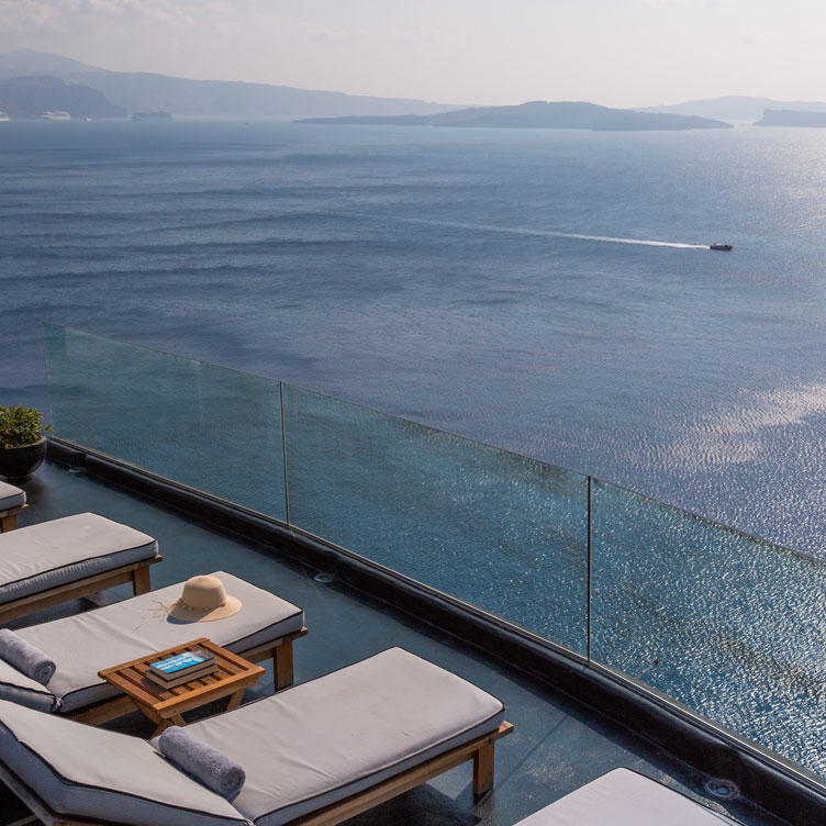 Breathtaking view from the luxury pool of Nostos Apartments in Oia Santorini