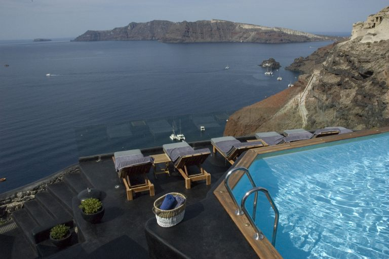 The breathtaking view from the pool of Nostos Apartments in Oia Santorini