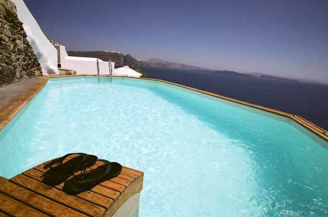 The superb view from the pool of the luxury Nostos Apartment in Oia Santorini