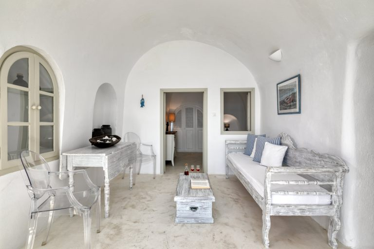 The spacious and modern living room inside the luxury boutique hotel Nostos Apartments in Oia Santorini