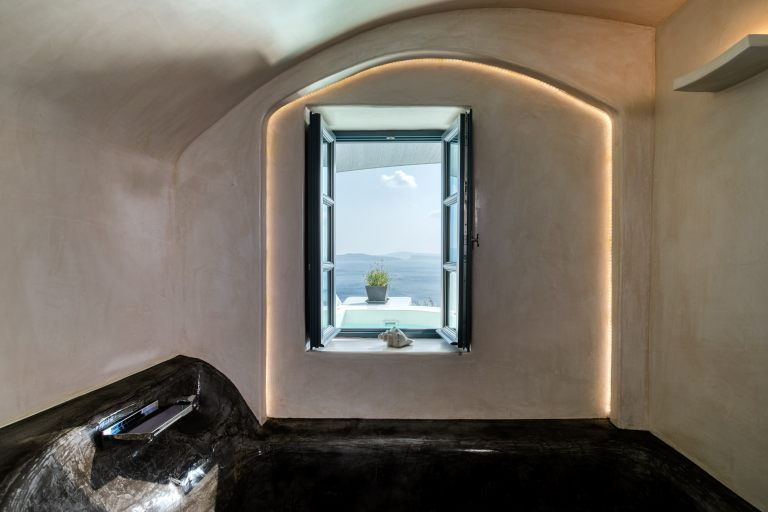 The magnificent view from the window of Nostos Apartments in Oia Santorini