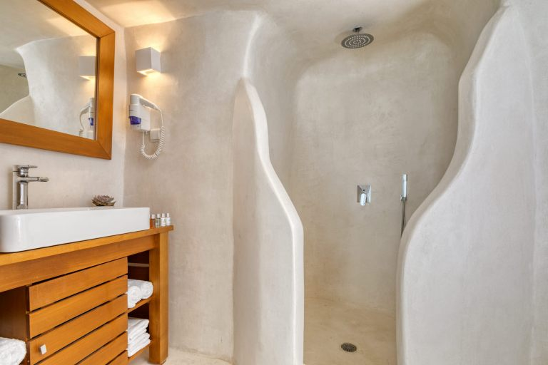 The shower of the traditional cave studio of Nostos Apartments in Oia Santorini.