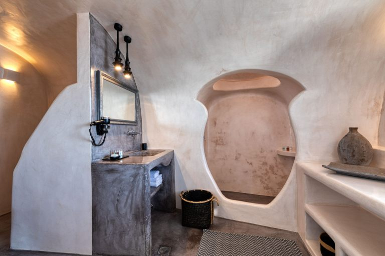 The traditional inside interior of the cave studio from Nostos Apartments in Oia Santorini