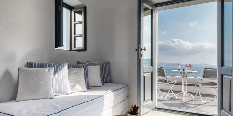 The interior of the luxury Junior Suite of Nostos Apartments in Oia Santorini
