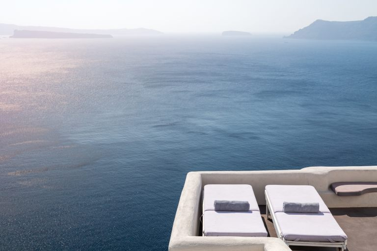 The amazing view from the bedroom of the luxury Junior Suite of Nostos Apartments in Oia Santorini
