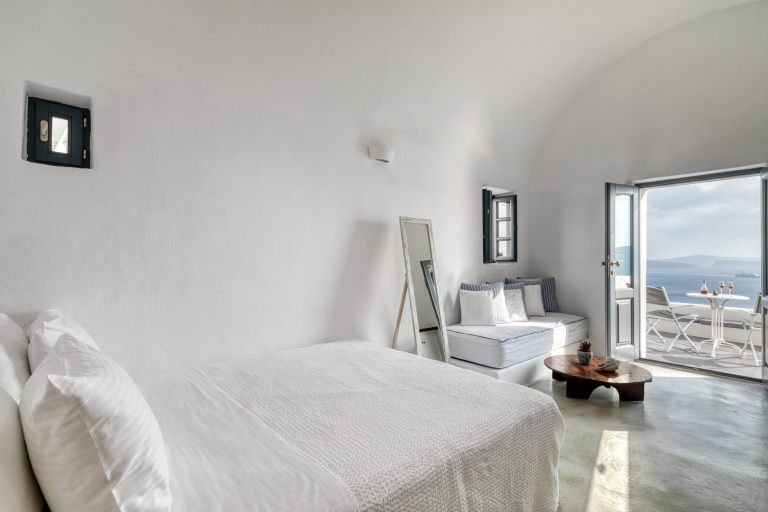 The comfortable bed inside the luxury Junior Suite of Nostos Apartments in Oia Santorini