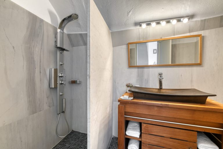 The shower of the luxury Junior Suite of Nostos Apartments in Oia Santorini