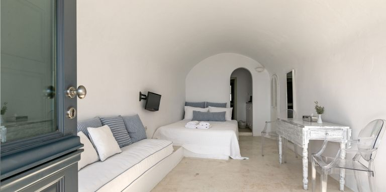 The cozy interior of the luxury studio of Nostos Apartments in Oia Santorini