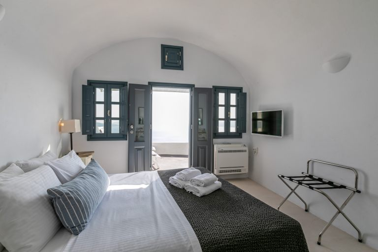 The comfortable double bed of the luxury apartment of Nostos Apartments in Oia Santorini